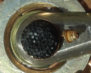 black sparkly found earring with copper backing and post attached